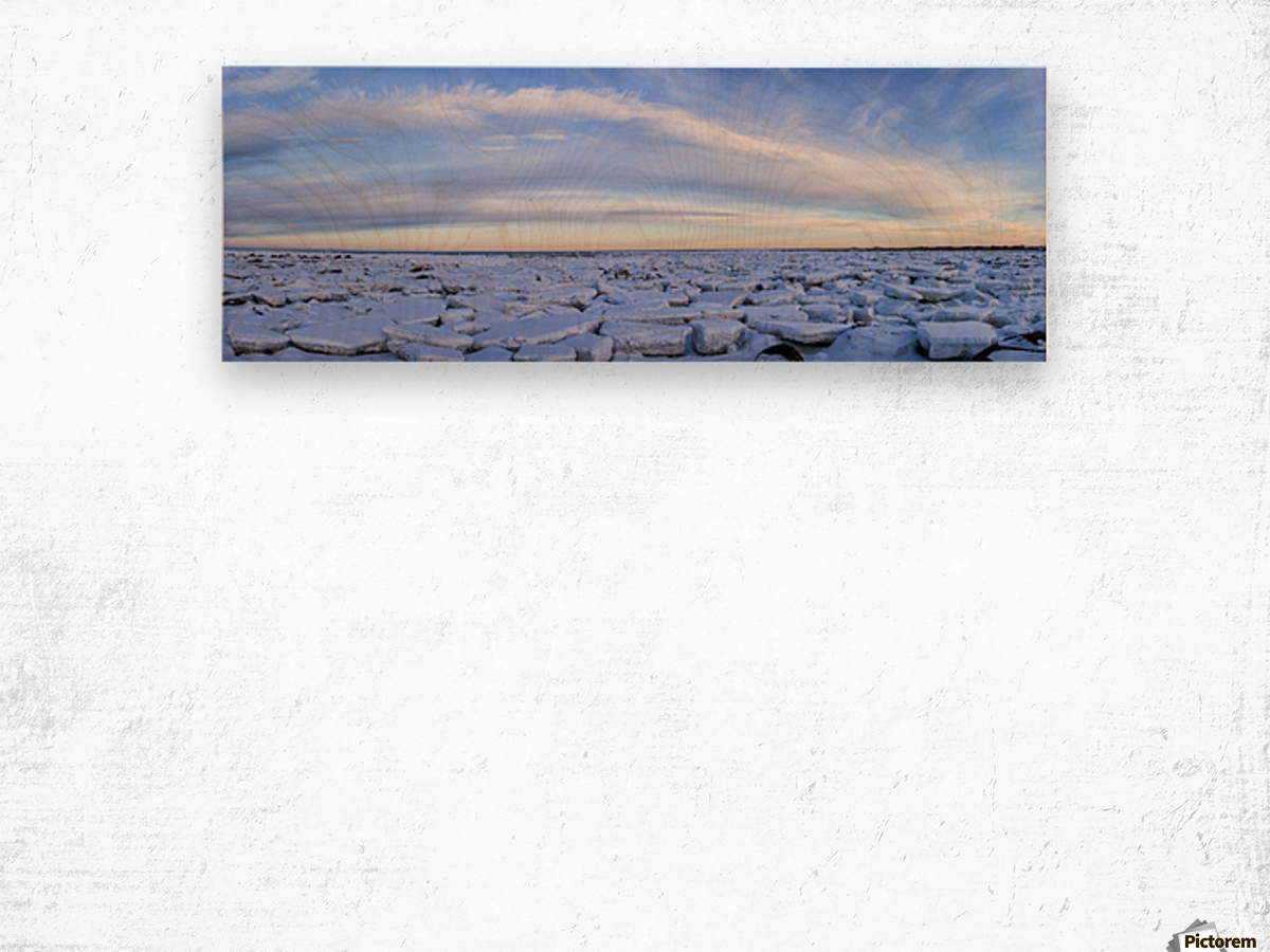 Ice forms on the shores of Hudson Bay as sunset starts to light up the clouds; Churchill, Manitoba, Canada Wood print