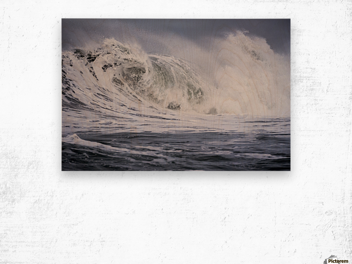 A large wave breaks on a stormy morning; Seaside, Oregon, United States of America Wood print