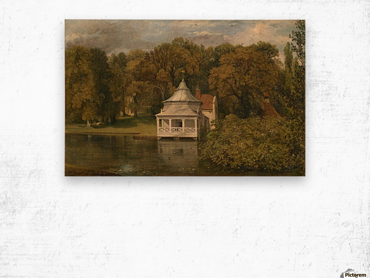 A small white cottage by the river Wood print